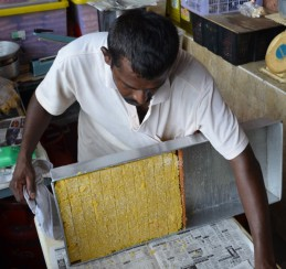 Stall holder making a sweet treat for the tourists at Batu Caves