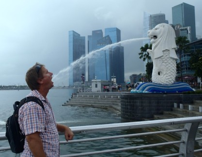 Wayne taking a drink from the Merlion