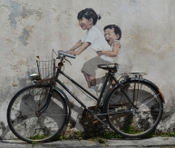 Penang's famous artwork is dotted around the city. The bike is real, the kids are painted on the wall.