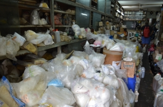 The Chemical Man - notice the narrow passage to the right of the piles of chemicals and powders.