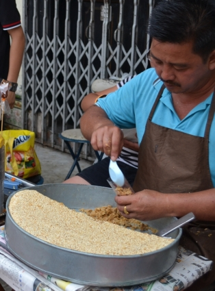 Local making peanut brittle for the tourists - Jonker Walk, Melaka