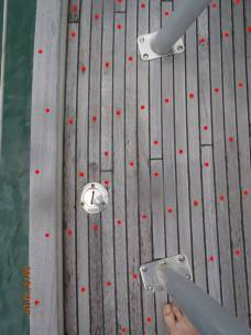 The red dots illustrate the hundreds of screw-holes on deck. Our new teak deck no longer has screws.