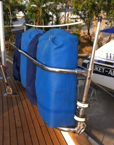 New holder made from old bimini frame keeps the jerry cans off the deck