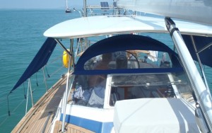 Out of the sun in our new hard bimini, spray hood and canvas shades