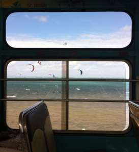 Kite surfers through the bus window