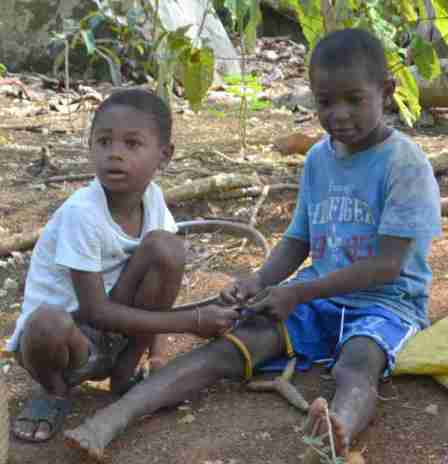 Boys making a slingshot