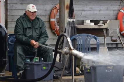 Fisherman washing his net
