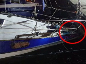 Bow wedged under dock